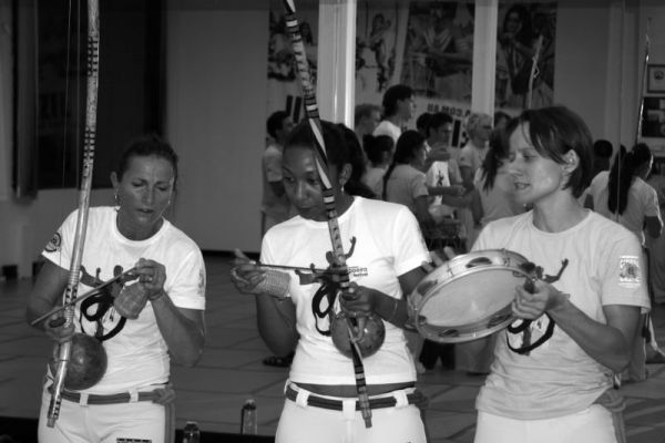 Girls of Capoeira Brasil Australia playing berimbau & pandeiro